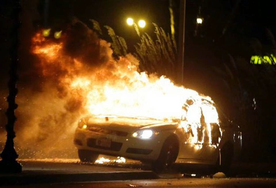 a Ferguson police car on fire, Nov. 24, 2014