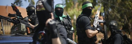 Members of Hamas' armed wing take part in the funeral of their comrades in Gaza City