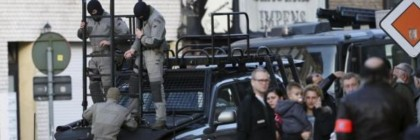 Belgian special forces handle a ladder near a building, where four gunmen have taken a man hostage, in Ghent