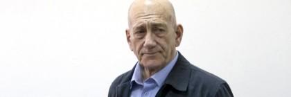 Former Israeli Prime Minister Ehud Olmert stands at Jerusalem District Court