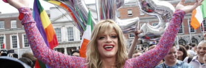 "Rory O'Neill, known by the Drag persona Panti, celebrates with yes supporters at Dublin Castle, Ireland, Saturday, May 23, 2015. Ireland has voted resoundingly to legalize gay marriage in the world's first national vote on the issue, leaders on both sides of the Irish referendum declared Saturday even as official ballot counting continued. Senior figures from the ""no"" campaign, who sought to prevent Ireland's constitution from being amended to permit same-sex marriages, say the only question is how large the ""yes"" side's margin of victory will be from Friday's vote. (AP Photo/Peter Morrison)"