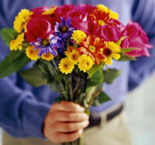 man-giving-flowers