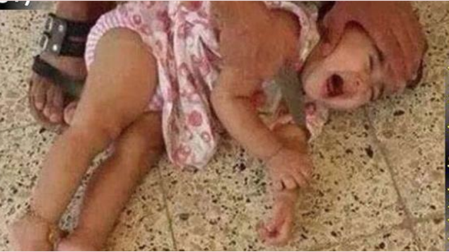 Islamic State terrorists (ISIS) beheading a baby girl