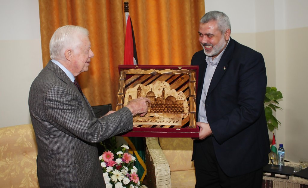 Jimmy Carter meeting with the Hamas terrorist group's leader in Gaza.