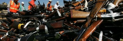 RANCHO CUCAMONGA, CA - JULY 12: Steel workers look over a pile of more than 4,300 confiscated illegal weapons about to be melted down during the 14th Annual Gun Destruction program, overseen by Los Angeles County Sheriff Lee Baca, at the TAMCO steel mill on July 12, 2007 in Rancho Cucamonga, California. The weapons were confiscated throughout Los Angeles County over the past year and must by law be destroyed. The guns make ideal scrap metal for making concrete reinforcing bars, or rebar, because of their typically high nickel and chrome content and will ultimately be used in the construction of California freeways.  (Photo by David McNew/Getty Images)