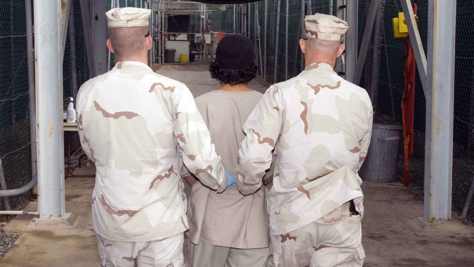 captive_being_escorted_for_medical_care_december_2007