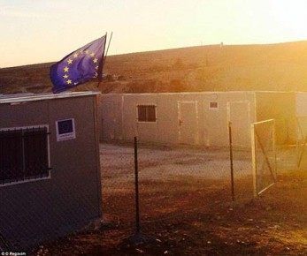 EU-flag-flying-above-an-illegal-building-erected-for-Arabs-in-Israel-controlled-Area-C