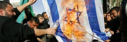 Palestinian supporters of Hamas burn an Israeli flag  during a demonstration outside the destroyed parliament building in Gaza City on January 30, 2009.  (UPI Photo/Ismael Mohamad)