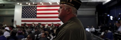 Vietnam veteran Jim Mickendrow of Summerville, South Carolina waits for the start of a Pearl Harbor Day Rally aboard the USS Yorktown Memorial for U.S. Republican presidential candidate Donald Trump in Mount Pleasant, South Carolina, December 7, 2015.  REUTERS/Randall Hill - RTX1XN79