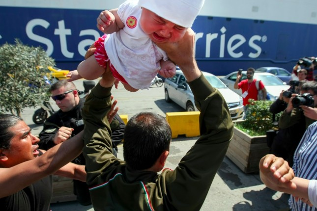 migrant_throwing_baby