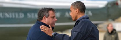 US President Barack Obama (R) is greeted by New Jersey Governor Chris Christie upon arriving in Atlantic City, New Jersey, on October 31, 2012 to visit areas hardest hit by the unprecedented cyclone Sandy. Americans sifted through the wreckage of superstorm Sandy on Wednesday as millions remained without power. The storm carved a trail of devastation across New York City and New Jersey, killing dozens of people in several states, swamping miles of coastline, and throwing the tied-up White House race into disarray just days before the vote. AFP PHOTO/Jewel Samad        (Photo credit should read JEWEL SAMAD/AFP/Getty Images)