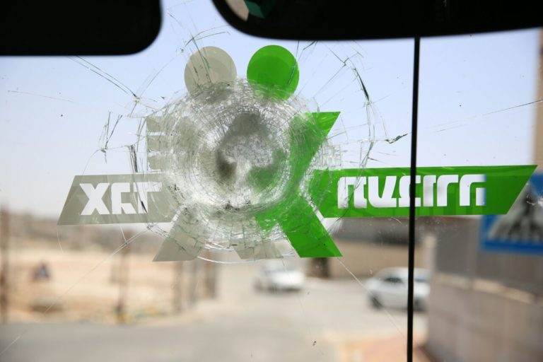 The windshield of a bus damaged near Hizme.