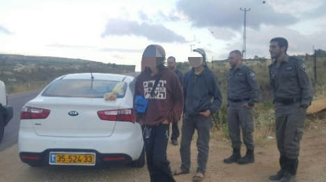 One of the youths arrested on the hilltop with his teffilin strapped on his shoulder.