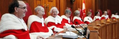 Justice Michael Moldaver (left) shares a laugh with his Supreme Court colleagues during a welcoming ceremony in the Supreme Court of Canada, Monday November 14, 2011.THE CANADIAN PRESS/Fred Chartrand