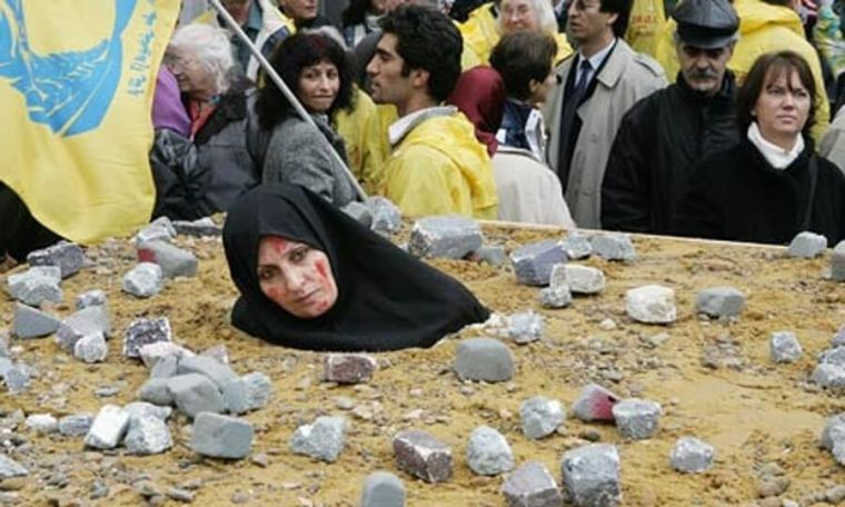 Muslim woman stoned to death in public.